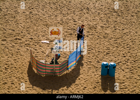 Man Erecting Punch and Judy Show in Broadstairs, Kent - Stock Photo