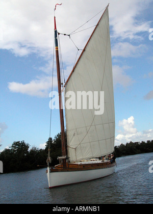 White Moth wherry yacht sailing on the River Bure Norfolk Broads, Broads National Park - Stock Photo