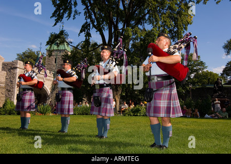 Military pipe and drum band at tatoo, Porte St. Louis, one of the entrances of the walled city of old Quebec, Quebec, - Stock Photo