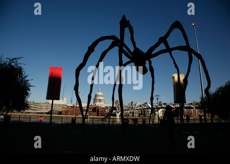 St Pauls Cathedral framed by Maman sculpture outside the Tate Modern, Bankside, London - Stock Photo