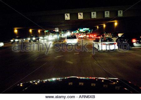 Night Traffic at intersection in Tempe Arizona Baseline  Road underneath Interstate Ten Freeway Phoenix  Arizona - Stock Photo