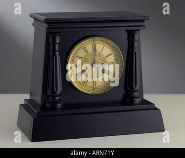 slate cased mantel clock by Jean Baptiste Deletrez, circa 1865 - Stock Photo