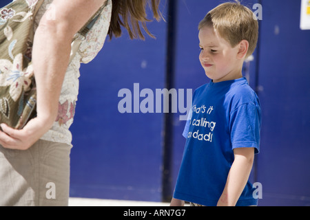 Young naughty boy being scolded by his Mother - Stock Photo