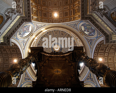 Interior of Saint Peters Basilica looking up from below the 20 meter high tabernacle Vatican city Rome Italy - Stock Photo
