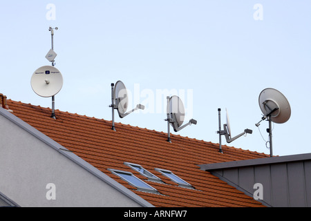 Satellite dishes on roof - Stock Photo
