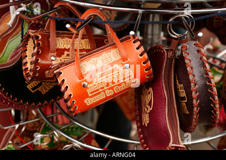 Souvenir handbag on sale  in a market in Beijing China - Stock Photo