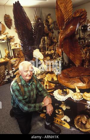 Qualicum Beach Local artisan, woodcarver Paul Bourbeau in his studio, Vancouver Island, British Columbia, Canada. - Stock Photo