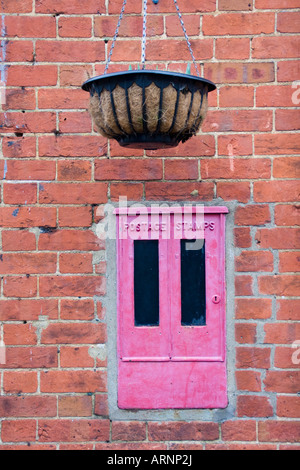 Postage Stamp Box and Hanging Basket in the village of Shere, Surrey - Stock Photo