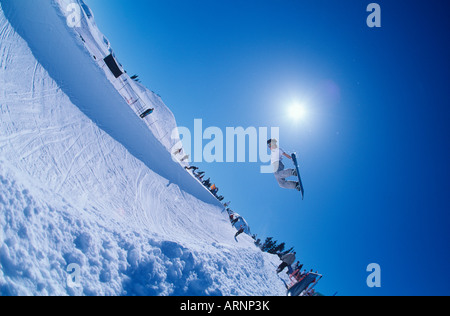 snowboarder in half pipe competition, Whistler, British Columbia, Canada. - Stock Photo