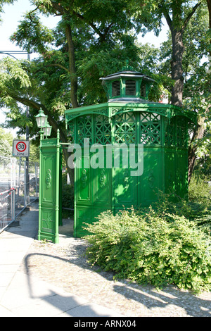 Traditional original pissoir public toilet in the street in Berlin Germany - Stock Photo