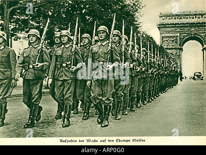 German Troops in the Champs Elysees 1940 propaganda photo of the Wehrmacht marching in Paris - Stock Photo