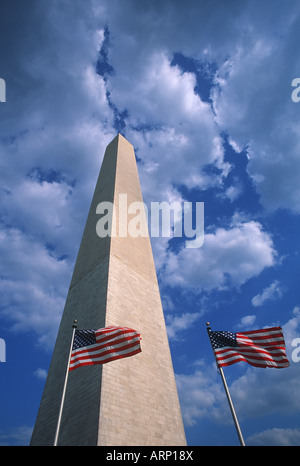 USA, Washington, DC, Washington Monument and US Flags - Stock Photo