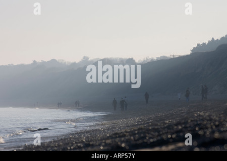 People out enjoying the early spring weather in Dunwich Beach - Stock Photo
