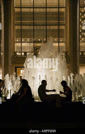 People gathered around the fountain in the main COURTYARD of LINCOLN CENTER at night NEW YORK CITY - Stock Photo