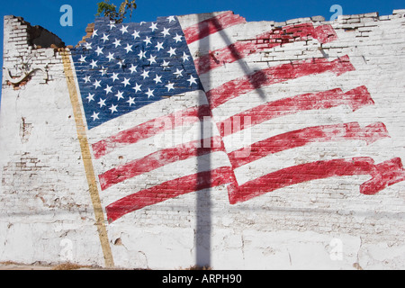 Faded Painted American Flag on a Crumbling Building, Calvert, Texas - Stock Photo