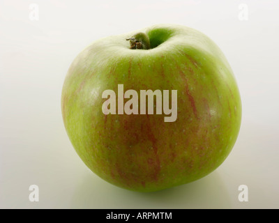 Close up of whole Bramley apple isolated against a white background - Stock Photo