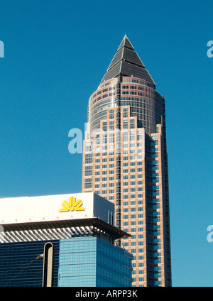 The MesseTurm or Trade Fair Tower seen behind the Commerzbank in the Messegelande complex in central area of Frankfurt, - Stock Photo