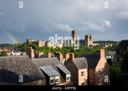 Durham, County Durham, England. View across rooftops to the castle and cathedral beneath a stormy sky. - Stock Photo