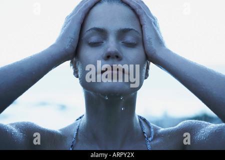Young Woman in rain wearing bikini