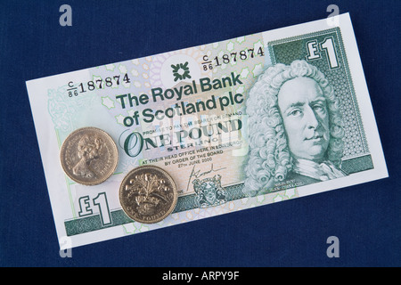 dh Royal Bank of Scotland MONEY SCOTLAND UK scottish one pound note sterling coins banknotes cash coin banknote - Stock Photo