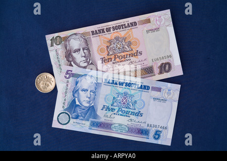 dh Bank of Scotland cash MONEY SCOTLAND UK Scottish five ten pound notes one pound sterling thistle coin paper currency - Stock Photo