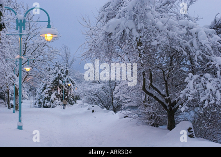 Snow storm covers Seawall Harbourside walkway in heavy snow Nanaimo Vancouver Island British Columbia Canada - Stock Photo