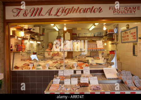 DEWSBURY TOWN CENTRE MARKET STALL SELLING FRESH FISH POULTRY AND GAME - Stock Photo