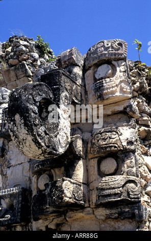 Detailed carving of Gods on Mayan ruins in Mexico head of Quetzalcoatl - Stock Photo