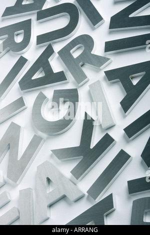 Stylish letters cut out of polished steel - Stock Photo