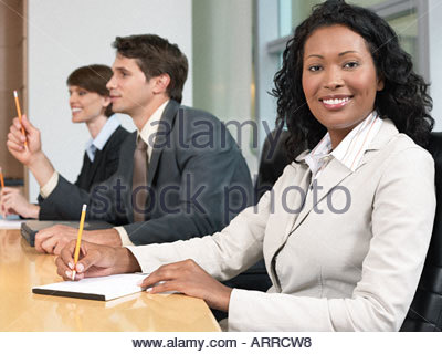 Businesswoman and colleagues in a meeting - Stock Photo