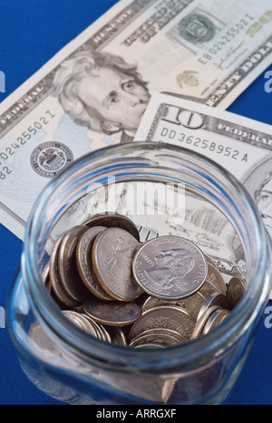 Banknotes and coins in a jar