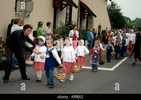 Children parade in the annual wine festival, or biou, in Pupilllin, a winemaking village in France's Jura region - Stock Photo