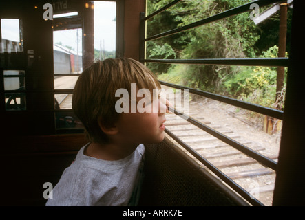 Boy aged three looks out of window of tram at Shore Line Trolley Museum at East Haven near New Haven Connecticut - Stock Photo