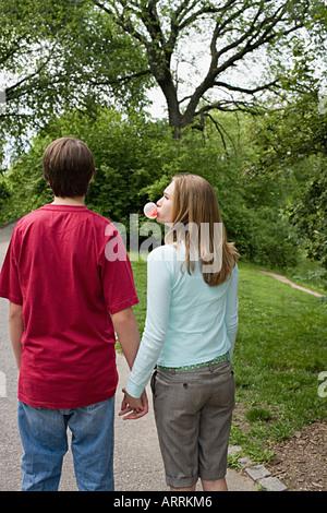 Teenage girl blowing a bubble gum bubble
