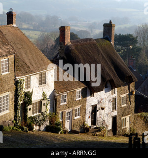 Gold Hill made famous by Hovis Advertisement in Shaftesbury Dorset England Edge of Town Housing Wintertime landscape - Stock Photo