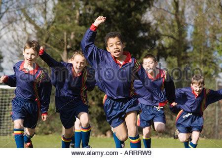 Boys celebrating a goal - Stock Photo