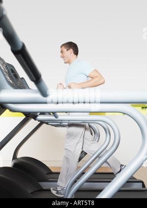 Man on treadmill in health club