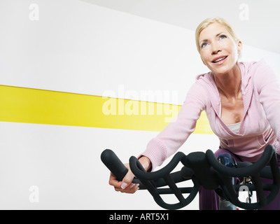 A Woman Cycling On An Exercise Bike Stock Photo Royalty Free