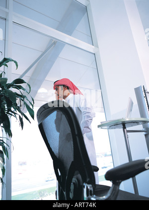 Thinking Arab businessman in his office - Stock Photo