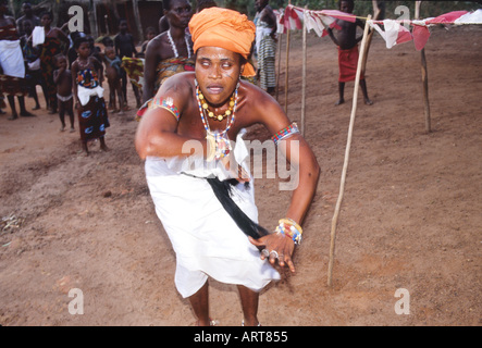 Woman in trance, Voodoo cult on a beach in Cotonou, Benin