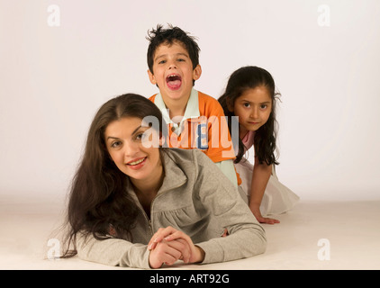 Mother and her kids having fun - Stock Photo