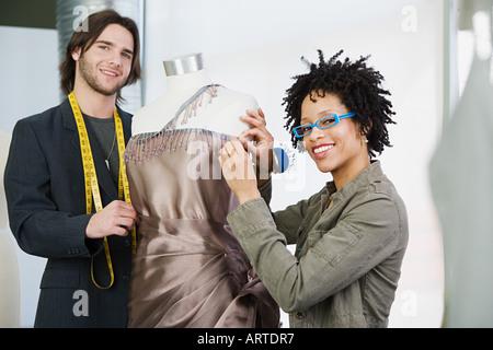 Tailors working on dress - Stock Photo