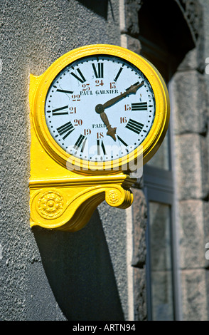 Yellow clock showing time, for the passengers of the Train Jaune at Odeillo-Font Romeu station,  in  Pyreneans mountains, - Stock Photo