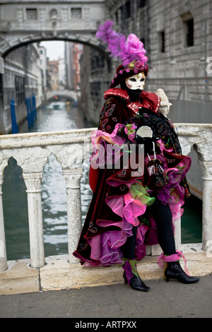 Portrait of a person dressed in Carnival costume and mask Venice Carnival Veneto Italy - Stock Photo