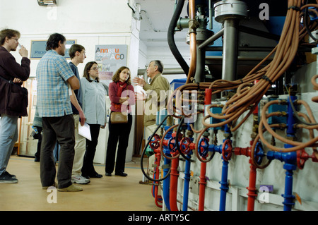 Teens Visiting in Science Lab at University of Paris South, France. Synchotron Electro Magnetic Atom Collision Ring - Stock Photo