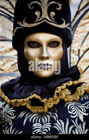 Portrait of a person dressed in Carnival costume and gold mask Venice Carnival Veneto Italy - Stock Photo