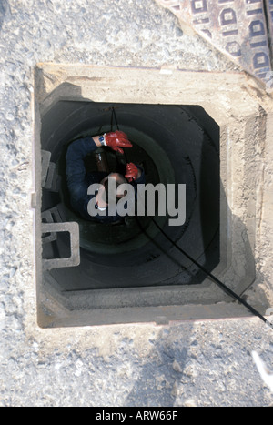 Inspecting a sewer using CCTV - Stock Photo