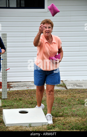 Female Senior Retired Citizens Play Game Of Bean Bag Toss