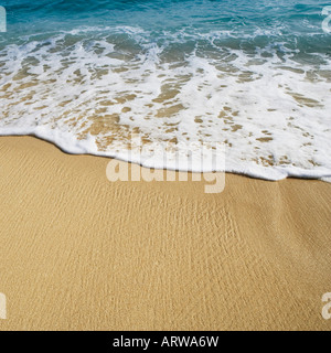 High angle view of waves breaking on the beach - Stock Photo