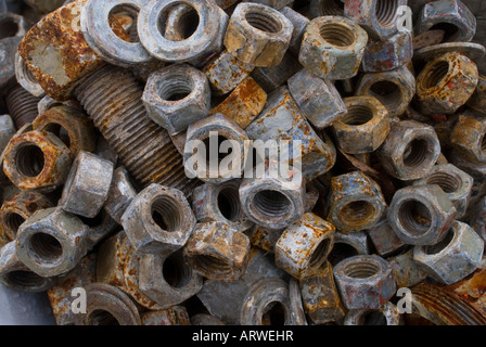 Pile of rusted nuts - Stock Photo